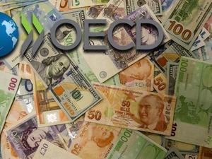 OECD, dünya ekonomisi için 2018 büyüme tahminini yüzde 3,7'de tutarken, 2019'a ilişkin büyüme tahminini 0,2 puan düşürerek yüzde 3,5 olarak açıkladı.
