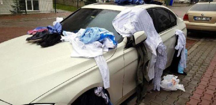 Eve gelmeyen eşinin kıyafetlerini otomobile bağlayıp not yazdı