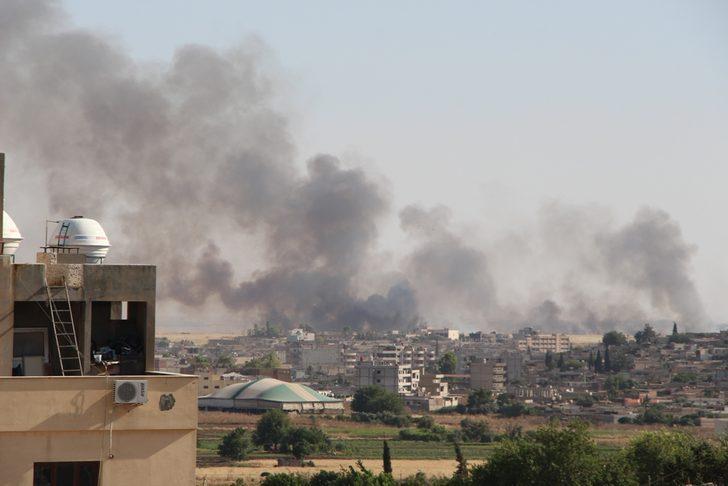 Suriye'de tarlada çıkan yangın, Nusaybin'den görüntülendi