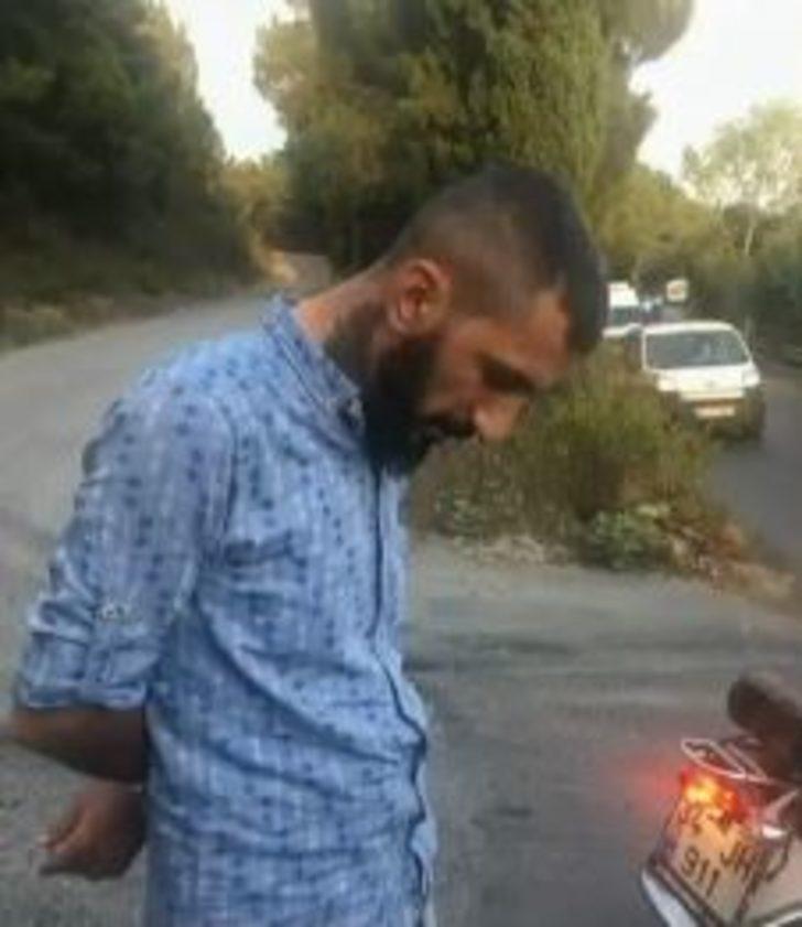 Pendik'te orman yangınıyla ilgili gözaltına alınan şüphelinin fotoğrafı