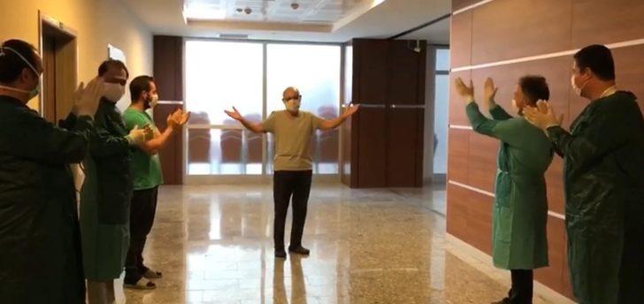 Koronavirüsü yenen doktoru mesai arkadaşları alkışlarla taburcu etti