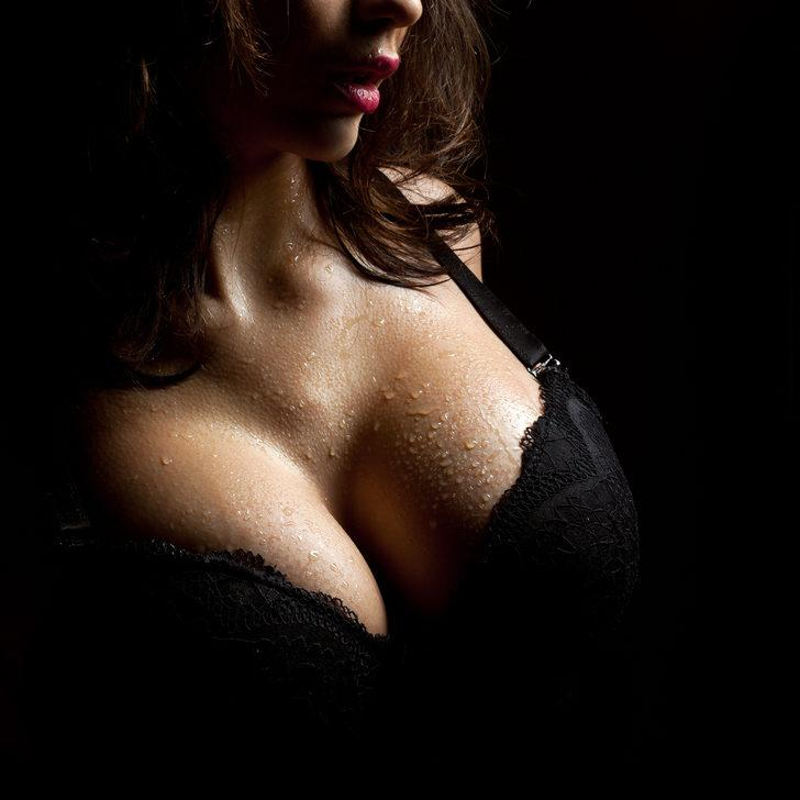 Beautiful big female breasts black bra stock photo