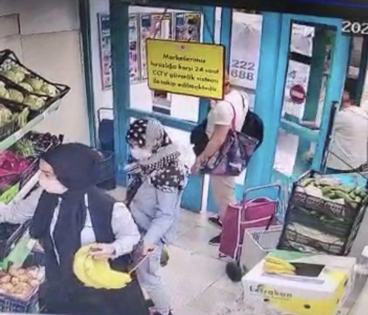 (Özel) Yankesici çetesinin kadının cebinden telefonunu çaldığı anlar kamerada