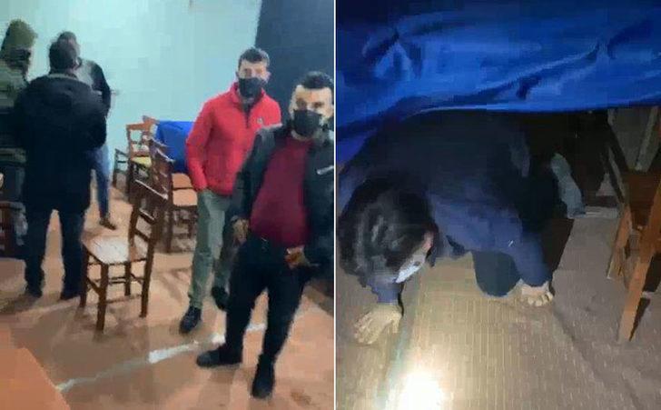 Baskın yapan polisi görünce masaların altına saklandılar