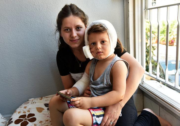 Sevmek istediği köpeğin saldırdığı çocuk ölümden döndü