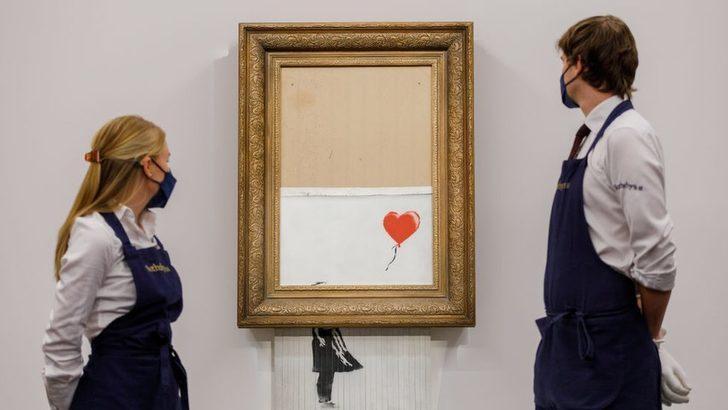 Banksy'nin müzayede sonunda 'parçalanan' eseri 16 milyon sterline satıldı