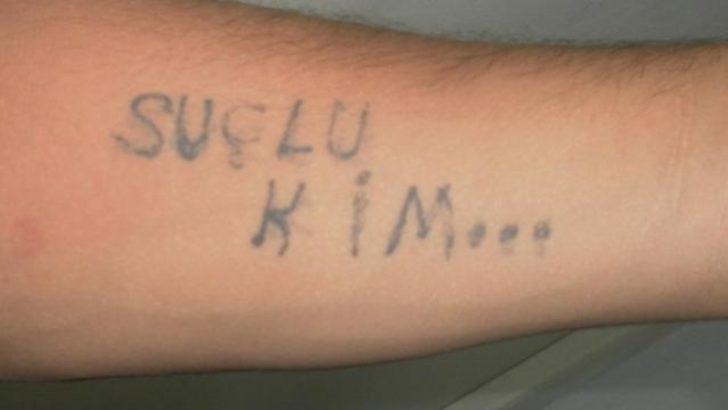 Hırsızın kolunda 'suçlu kim' yazısı