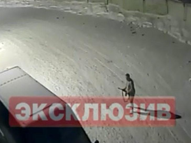 Çıplak koruma karda hırsız kovaladı!
